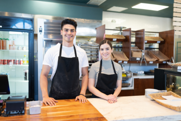 friendly faces at a cafe ready to provide great customer service