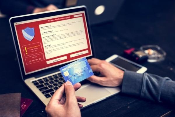 Person verifiying credit card details online.