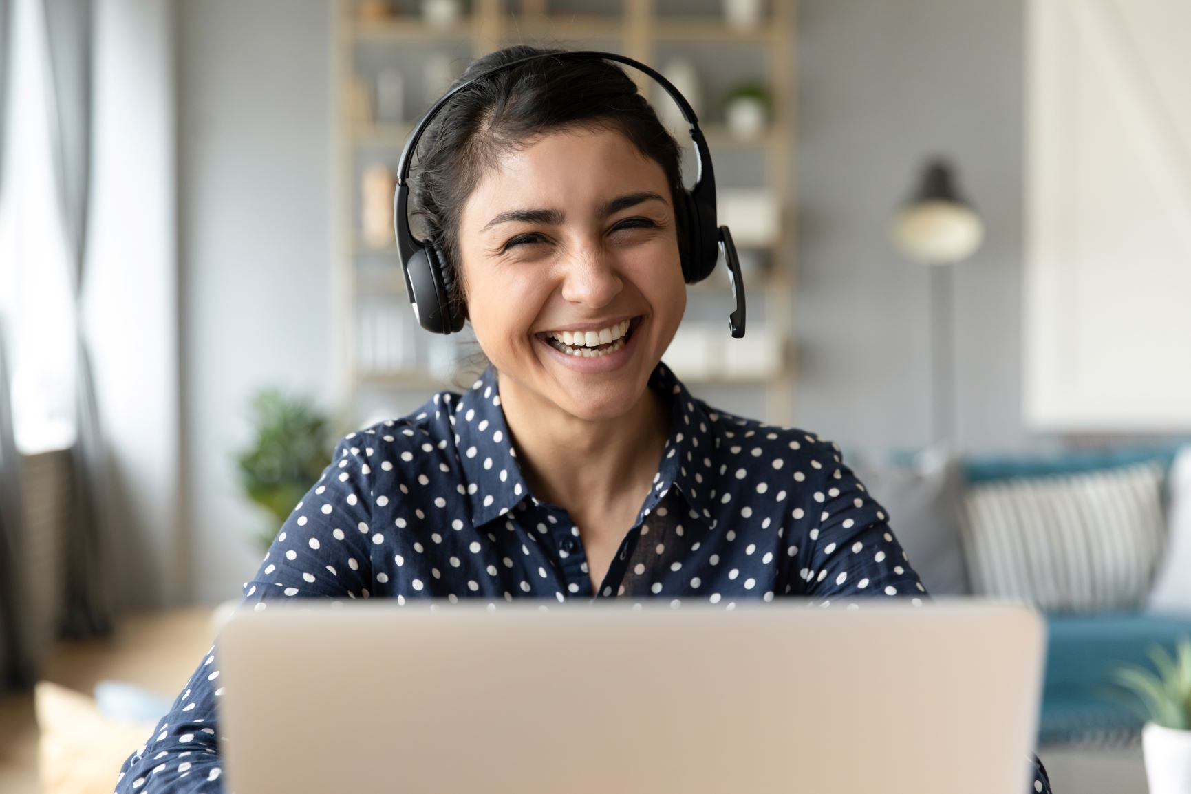 friendly woman with headset smiling at the camera